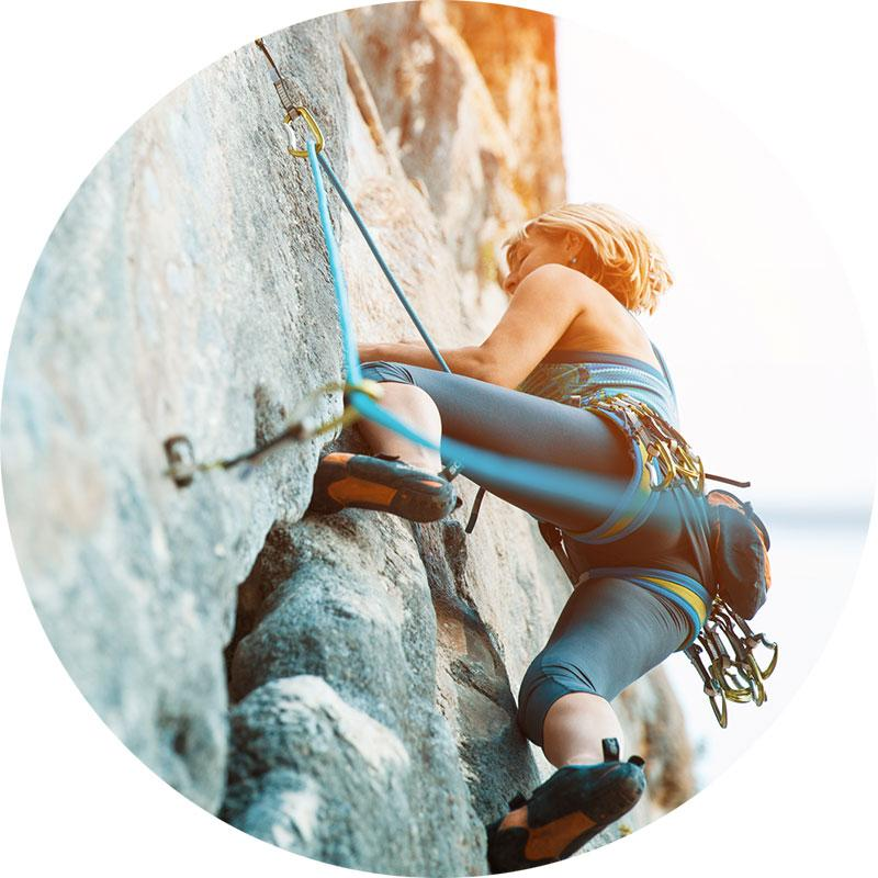Define Risk image, woman climbing